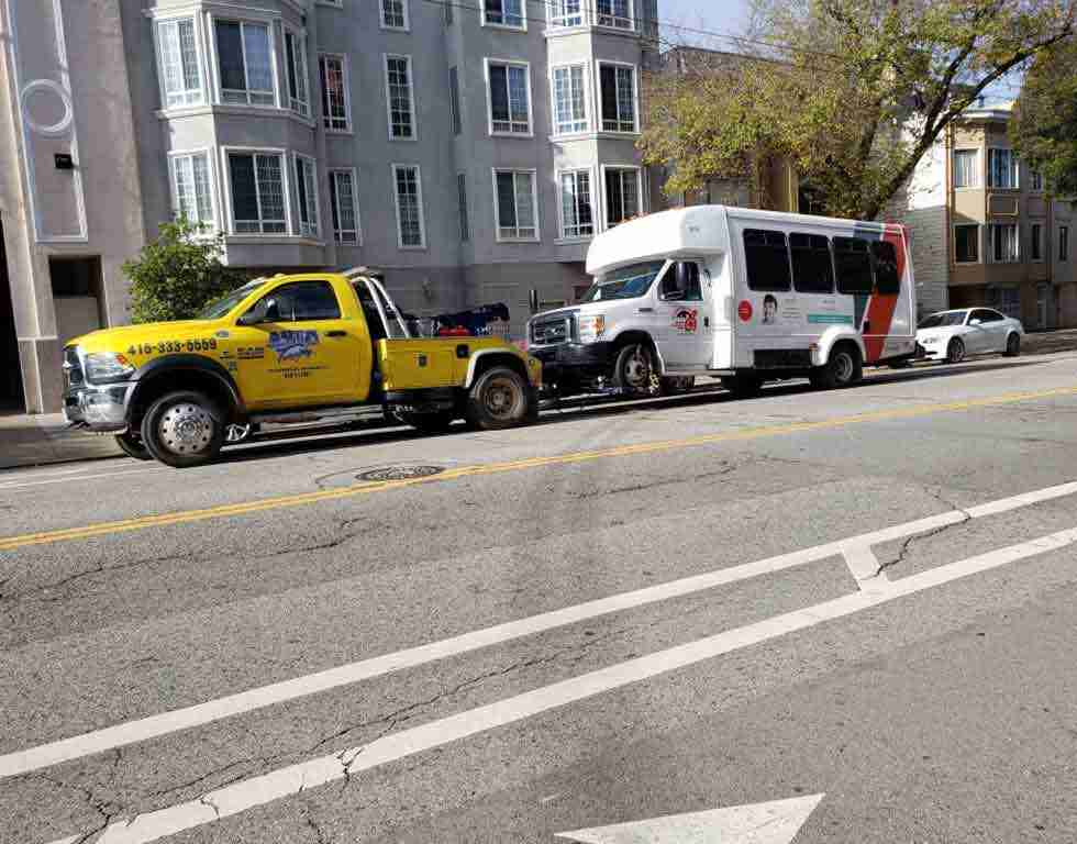 Transit bus being transported in SF CA using wheel lift towing | Auto Towing | 415-333-5559