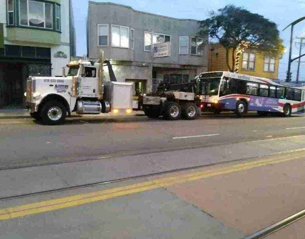 Bus being towed by heavy duty wrecker in SF CA | Auto Towing | 415-333-5559