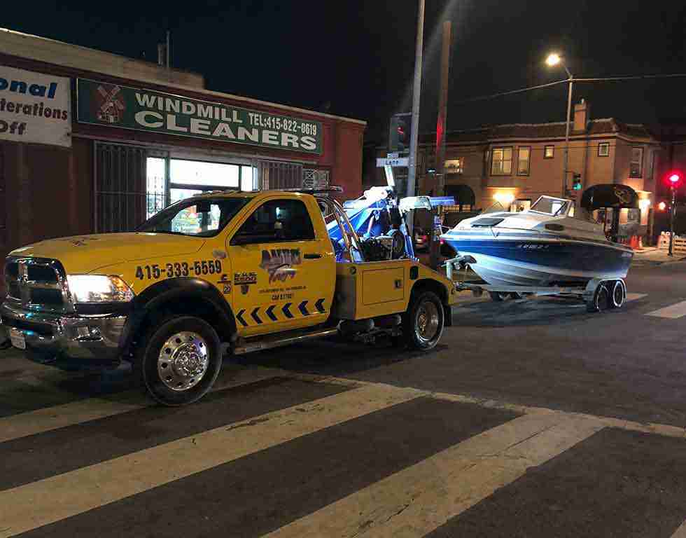 Boat being towed by sf towing service | Auto Towing | 415-333-5559