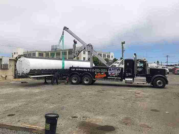 Heavy Duty tow truck lifting the back of semi San Mateo California