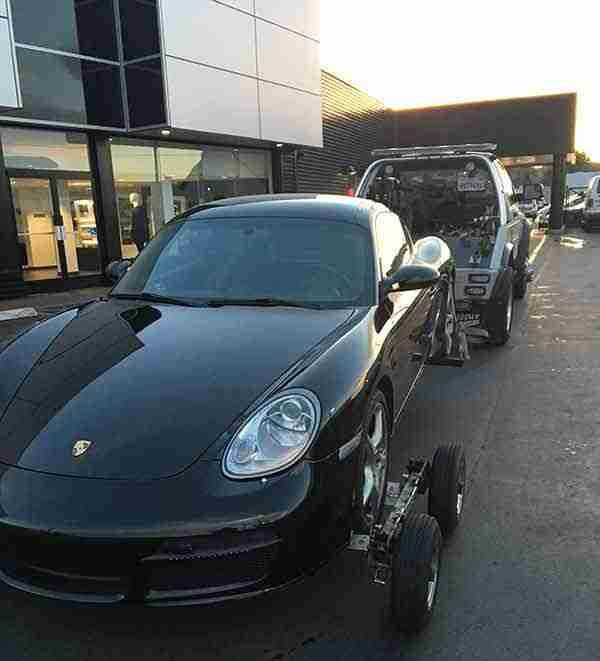Wheel Lift Tow truck with a porsche in San Francisco CA